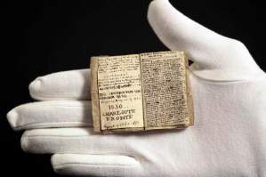 A curator at the Musee des Lettres et Manuscrits displays the miniature manuscript dated 1830 written by Charlotte Bronte, in Paris